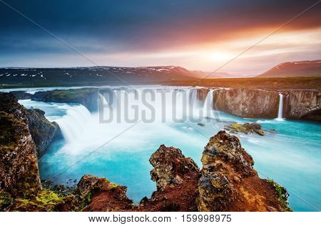 The rapid flow of water powerful Godafoss cascade. Popular tourist attraction. Unusual and gorgeous scene. Location Bardardalur valley, Skjalfandafljot river, Iceland, Europe. Beauty world.