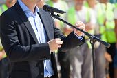 Public speaking. Presentation. Businessman or politician is giving a speech. poster