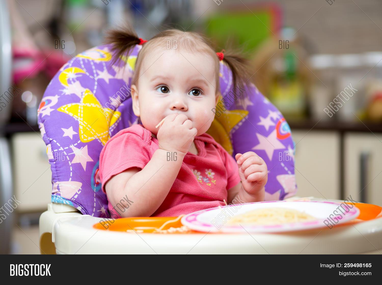 Baby Eats Pasta Image Photo Free Trial Bigstock