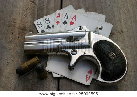 Circa 1889, Model 95, Type II Model 3 Double Derringer, on antique wooden table aces and eights aka a