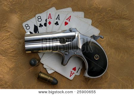 """Circa 1889, Model 95, Type II Model 3 Double Derringer"" lays ontop of Aces and Eights with shells"