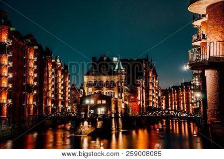 Hamburg, Germany. View Of Wandrahmsfleet At Dusk In Light Illumination. Located In Warehouse Distric