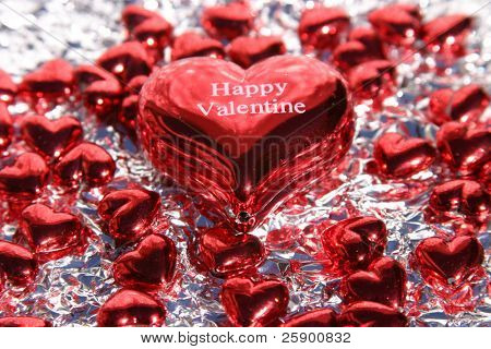 Valentines Day hearts on silver aluminum foil