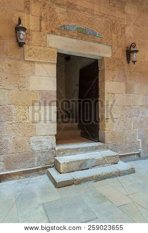 Ancient External Old Decorated Bricks Stone Wall And Doorway Leading To The House Of Egyptian Archit