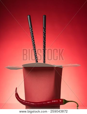 Spicy Chinese Noodles In Red Box And Chopsticks