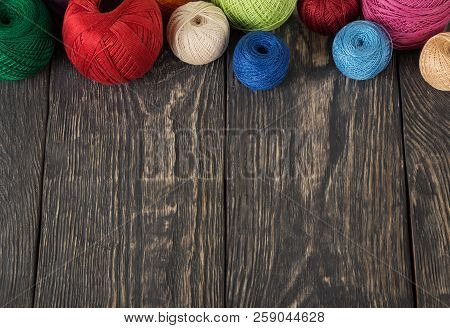 Women's Hobby. Colorful Skeins Of Yarn On Wooden Old Background.
