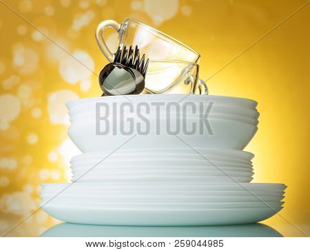 Cutlery And Dishes On Bright Yellow Background