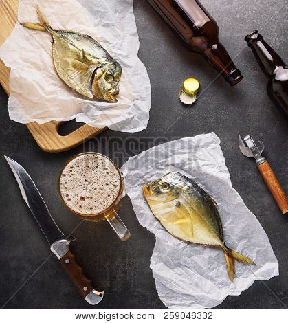 Frozen Beer, Snack, Dried Fish On Dark Table