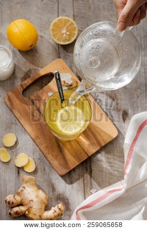 Cup Of Ginger Tea With Lemon. Cup Of Ginger Tea With Lemon. Glass Mug Of Green Hot Tea On Wooden Tab