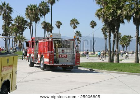 Emergency in Vencie Beach California. An unknown unidentifiable person suffers an apparent Heart Attack while playing basket ball.