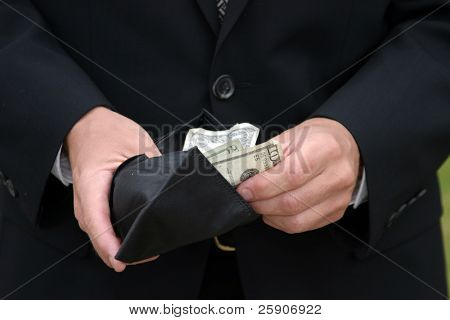 a person holds a fist full of money poster