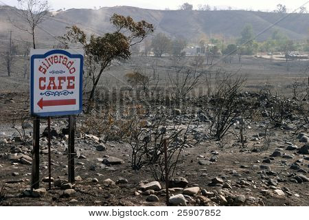 10-31-2007 Santiago Canyon Wild Fires Series. Burned landscape with the only thing not burned, a resturant sign