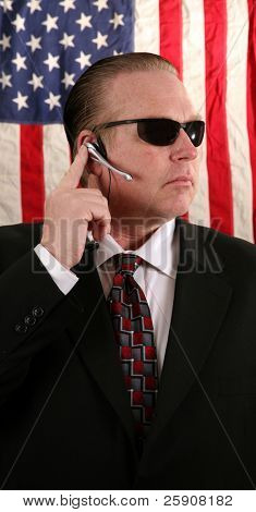 a Secret Service Agent speaks on his ear piece