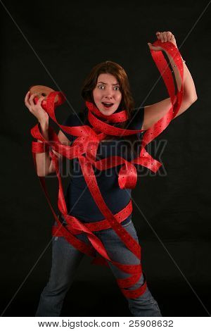 "a girl expresses frustration with the concept of being ""Caught up in Red Tape"" poster"