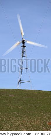 Windmills on a hill generate electricty
