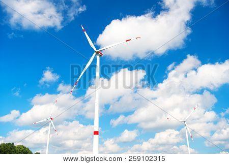 Turbine Or Windmill Blue Sky Background. Alternative Energy Source. Go Green Eco Friendly Technology