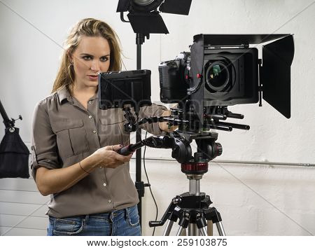 Photo Of A Woman Operating A Dslr Camera Rig For A Video Shoot.