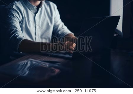 Businessman Working On A Laptop Late At Night