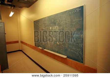 a chalk board with various figures and computations in a science laboratory