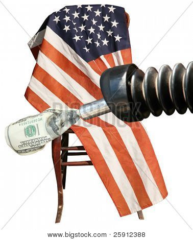 a gas nozzle with a one hundred dollar bill sits infront of an american flag isolated on white