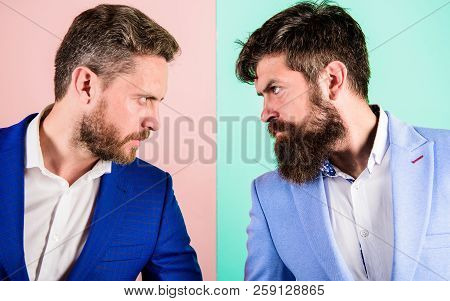 Business Partners Competitors Or Office Colleagues In Suits With Tense Bearded Faces Close Up. Hosti