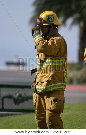 LAGUNA BEACH, CA - FEB 19: Firefighter recruit takes a break during fire fighting drills at the local Fire Department training area on February 19, 2009 in Laguna Beach, California.