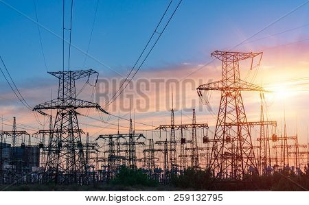 distribution electric substation with power lines and transformers, at sunset poster