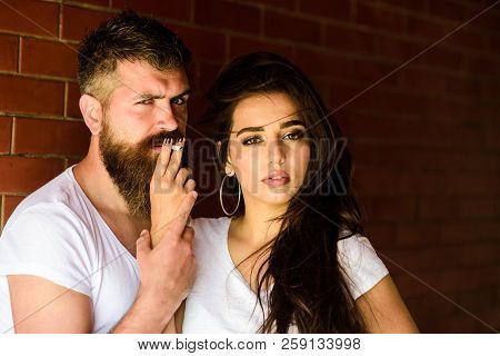 Couple In Love Hugs While Smoking Cigarette Brick Wall Background. Break Or Pause For Smoking. Share