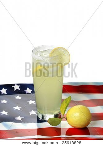 a glass of lemon aide and a fresh lemon on an american flag serving tray isolated on white