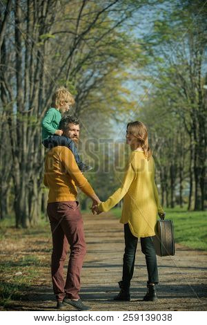 Happy Little Boy With Family Go On Journey In Park. Journey On Foot. Where Family Fun Begins.