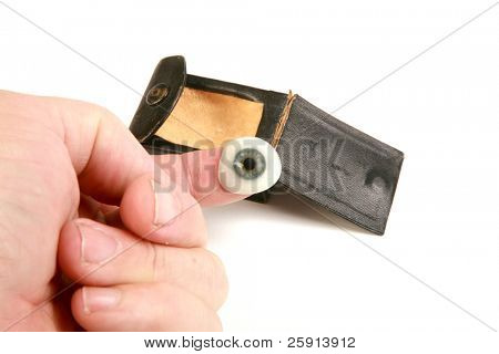 a human hand holds a genuine glass eye