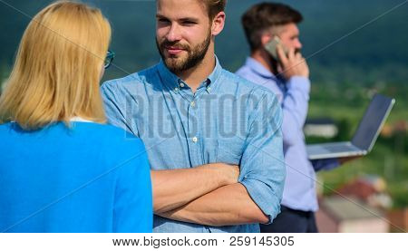 Couple Having Fun While Busy Businessman Speak On Phone. Couple Flirting While Man Busy With Mobile