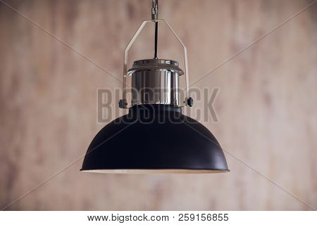 Black Decorative Lamp Hanging From The Ceiling.modern Lamp