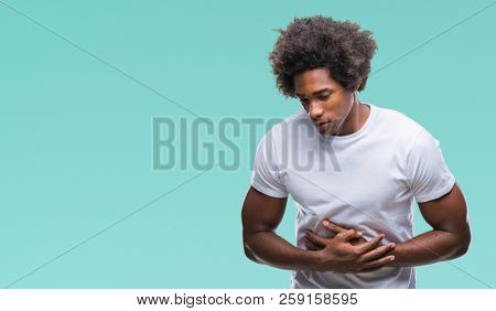Afro american man over isolated background with hand on stomach because nausea, painful disease feeling unwell. Ache concept.