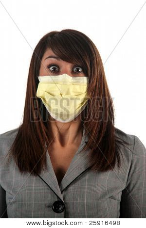 an attractive young woman wears a paper face mask to protect herself from the H1N1 Virus, isolated on white, with room for your text