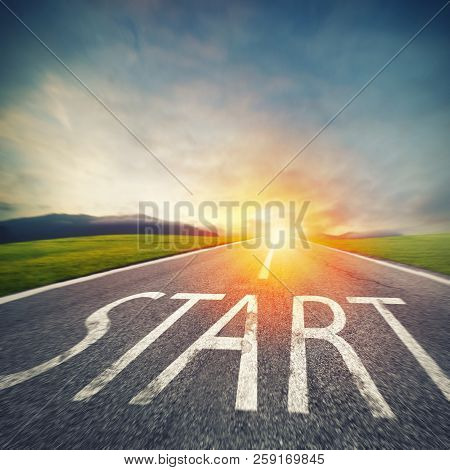 Start Written To The Ground On A Road At Sunset. Concept Of New Beginning And Starting New Opportuni