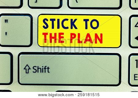 Handwriting Text Writing Stick To The Plan. Concept Meaning To Adhere To Some Plan And Not Deviate F