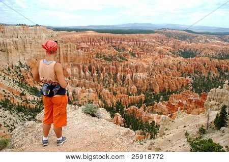 Woman stands looking over Bryce canyon