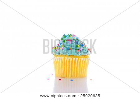 a cupcake with blue frosting, and sprinkles    isolated on white