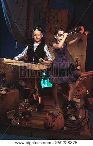 Children In Halloween Costumes Playing On Pirate Ship
