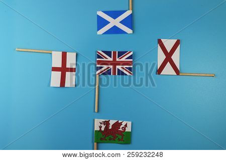 A United Kingdom Flag And Her Members As Scotland, England, Nothern Ireland, Wales. Blue Background