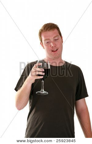a young man pours and enjoys a glass of red wine, isolated on white