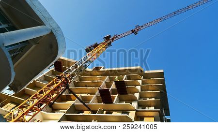 Construction Of A Multi-storey Building. Cranes Near Building. Commercial Business Project