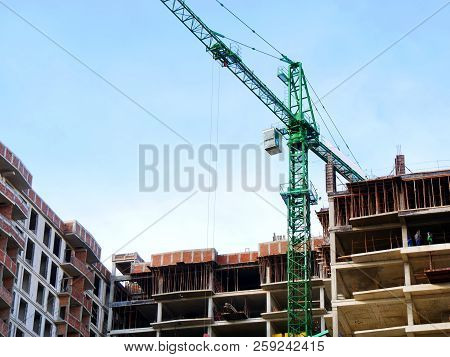 Construction Site. Building Site. Crane And Building Under Construction.