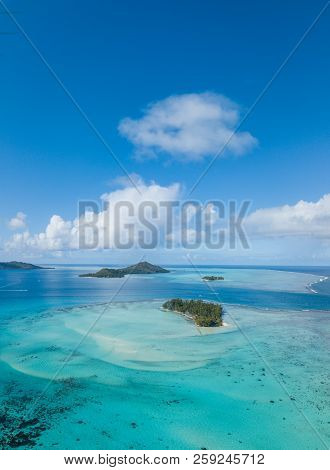 Aerial From A Drone Of Blue Lagoon And Otemanu Mountain At Bora Bora Island, Tahiti, French Polynesi