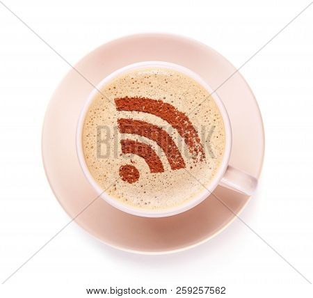 Cup Of Coffee With Wifi Sign On The Foam. Free Access Point To The Internet Wifi.