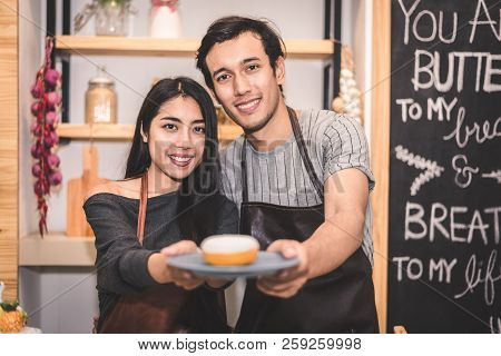 Young Couples Making Bakery Donuts And Bread At Bakery Shop As Business Ownership Entrepreneur. Husb