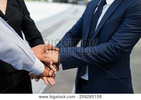 Businessman And Businesswoman Shaking Hands For Demonstrating Their Agreement To Sign Agreement Or C