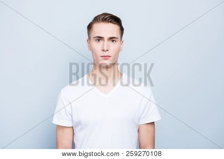 Portrait Of Nice, Good-looking Young Man Look At Camera Stand Isolated On Light Blue Background