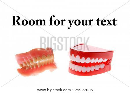 "a pair of dentures next to a pair of ""chattering teeth"" isolated on white with room for your text just dont confuse them and put in the wrong ones in the morning! poster"